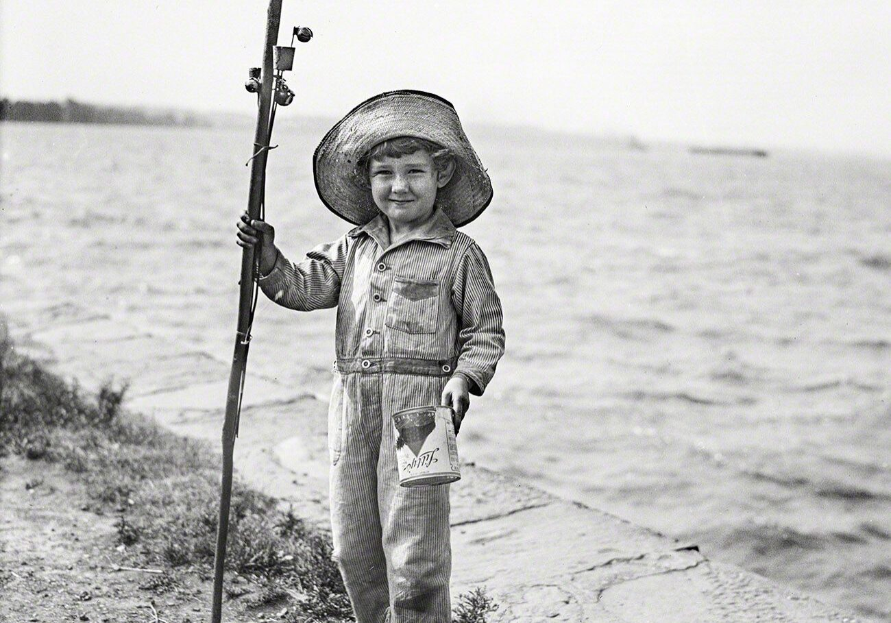 The_History_Of_Sportfishing_boy fishing with can of worms